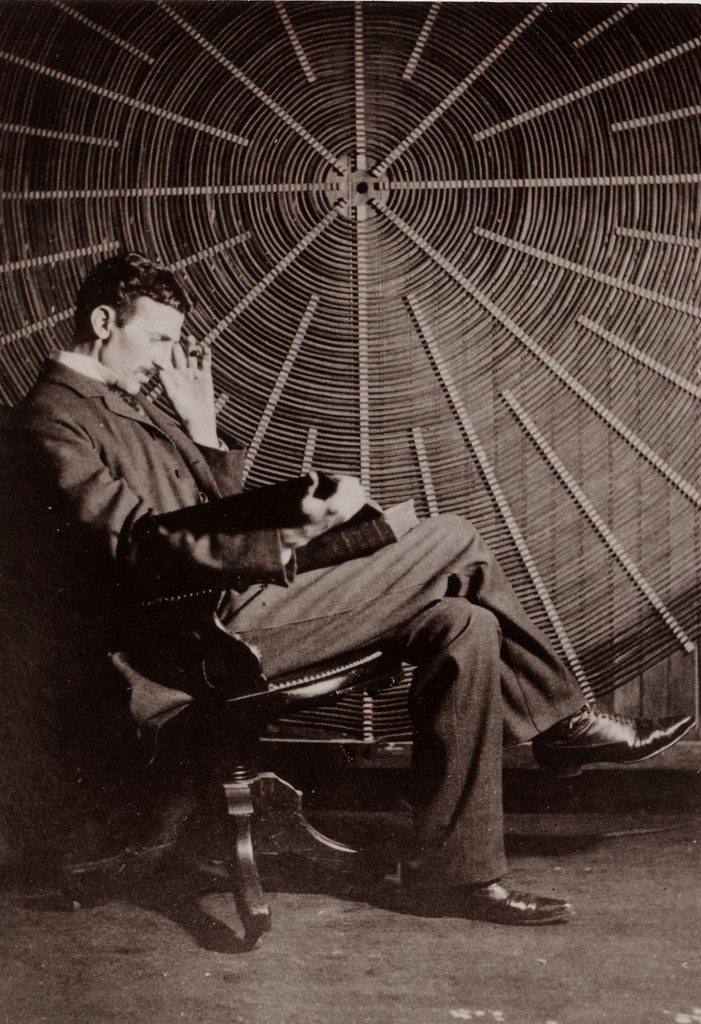 In one of the most famous pictures ever made of Nikola Tesla, we can see the inventor sitting in front of a humongous flat spiral coil in his lab on Houston Street, New York