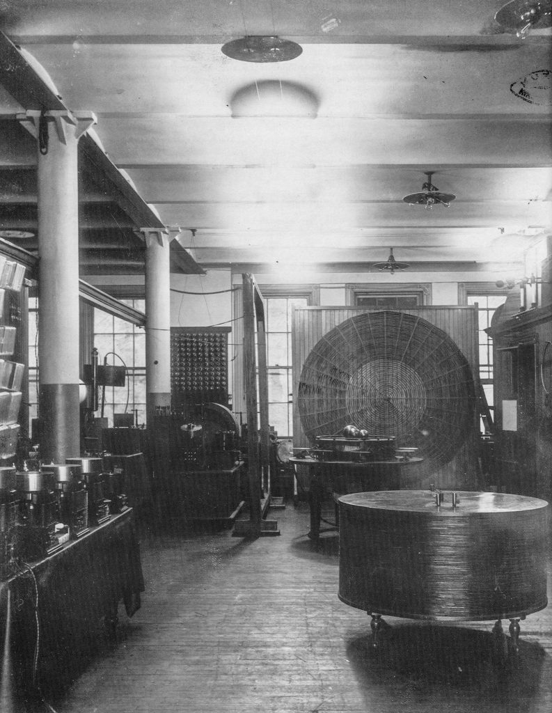 Houston Street lab, showing a spiral coil on the wall and a wide, short helical coil in the foreground